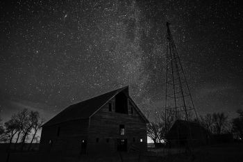 Looking northeast above the barn in McCook County and showing the faint winter Milky Way and the Andromeda galaxy (top left).