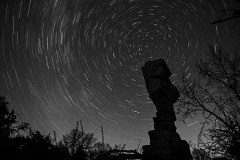 A half hour exposure shows stars circling the North Star above the Balancing Rock formation at Palisades State Park.