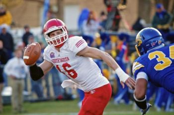 USD quarterback Josh Vander Maten scrambles for yardage.