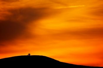 A couple enjoys a South Dakota sunset from atop Spirit Mound.