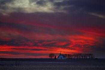 Post-sunset colors above Skrefsrud Lutheran Church east of Centerville.