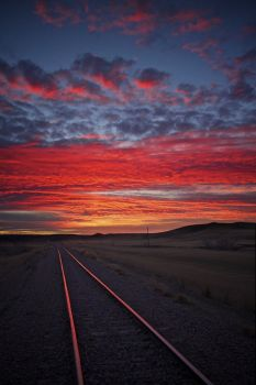 Railroad tracks along the Bad River Road at sunset.