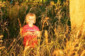 Exploring the tall grass in the perfect evening light makes a great end to a fun day at  Spirit Mound.