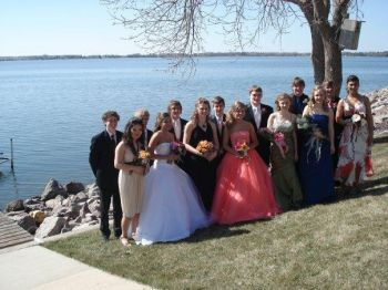 A beautiful daughter, a perfect dress and a bunch of good friends, all ready for prom.