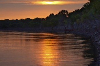 Sunset over a bend in the Missouri River, which borders the park.