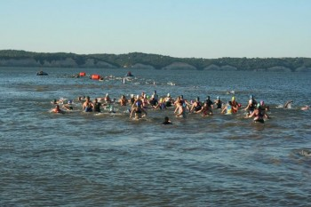 The female triathletes head into the water.