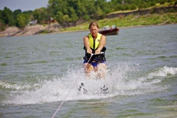 Jennifer DeJong shows off her water skiing prowess.