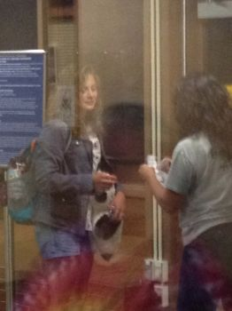 A last view through the airport glass as child #2 prepares to fly east, leaving her South Dakota home behind.