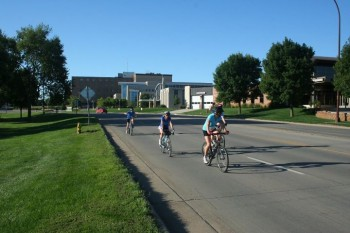 Athletes ride through Yankton on the 14.2 mile bike ride.