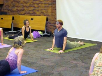 Sean Gallup from The Dharma Room teaches advanced yoga at the 2012 Sioux Falls Yoga Day.