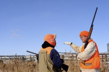 Landowner Nick Nemec explains his bird-surrounding plan to Lee Schoenbeck.