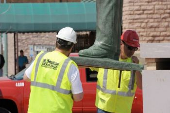 Workers carefully guided the 10-foot bronze to a 5-foot pedestal on the corner of Fifth and Phillips.