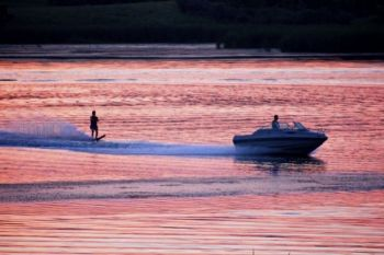 Waterskiing at sunset.