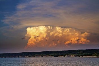 The last light of the day colors a thundercloud above the Missouri River north of Chamberlain.