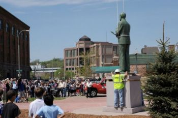 Students, families and downtown workers turned out during their lunch hour to watch the statue dedication.