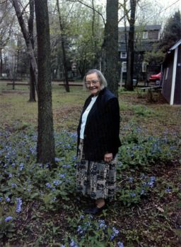 Mary Adams among flowers likely planted by her late sister Maud.