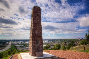 A quartzite marker stands near the murder site of two early Sioux Falls pioneers. Photo by Christian Begeman.