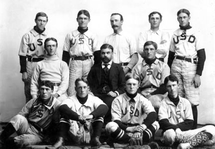 Professor Alexander Pell sits with members of the USD baseball team about 1900.