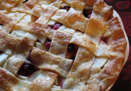 Warm apple cranberry pie with a dollop of vanilla ice cream is the perfect cap to your Thanksgiving meal.