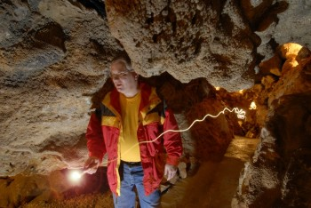 Self portraits with a long exposure, off-camera flash and streaking flashlight trails show photographer Chad Coppess visiting Black Hills Caverns near Rapid City.