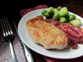 Soaking pork chops in a flavorful, beery brine results in most, tender meat. Photo by Fran Hill.