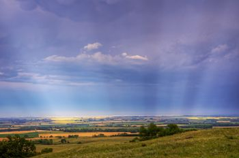 Sunrays through storm clouds on top of the Coteau de Prairie south of Sisseton.