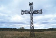 A 38-foot iron cross adorns the family cemetery at Brett and Tammy Prang s Frying Pan Guest Ranch. Photo by Bernie Hunhoff.