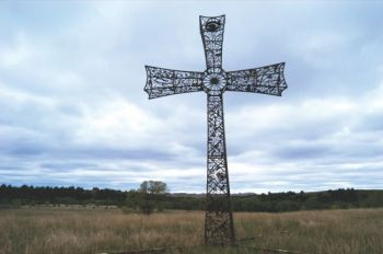 A 38-foot iron cross adorns the family cemetery at Brett and Tammy Prang's Frying Pan Guest Ranch. Photo by Bernie Hunhoff.