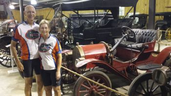 Carl and Jan pose next to Heritage Hall's 1908 Brush automobile.