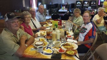 Carl and Jan enjoy spaghetti dinner with Charlie Eich (seated at the far end of the table) and other local seniors.