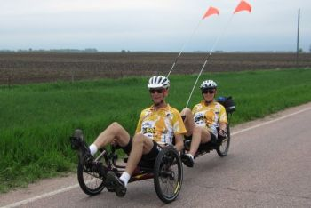 They ride a 27 speed, 10 foot long  tandem recumbent trike.