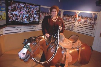 Dayle Tibbs Angyal says visitors to the Casey Tibbs Rodeo Center enjoy the exhibits and a chance to sit on a harmless bronc. Photo by Bernie Hunhoff.