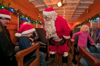 Santa visits with kids on the 1880 Train's Holiday Express. Photo by <a href='http://www.dakotagraph.com' target='_blank'>Chad Coppess</a> of SD Tourism.