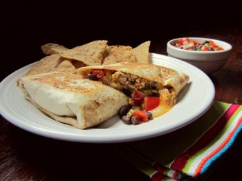 Shredded chicken, black beans and flavorful spices combined make a delicious burrito. Photo by Fran Hill.
