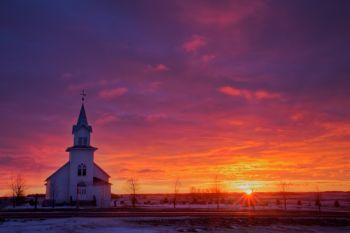 Highland Church with the rising sun.