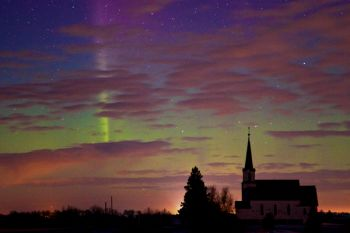 Oslo Church in Brookings County with departing clouds and faint Northern Lights.