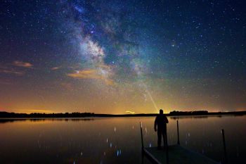 Summer nights can provide glassy water good enough to reflect starlight like this self-portrait with the Milky Way and a lightning bug photo bomb taken at Island Lake last summer.