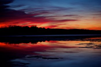 A late winter Lake Vermillion sunset after a melt and refreeze.