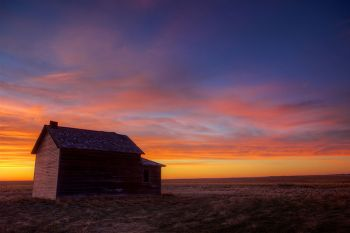 Sunrise along County Line Road in the Fort Pierre National Grasslands.