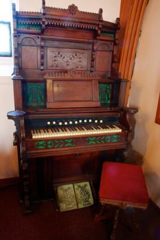 An old and ornate pump organ found at the back of the sanctuary.