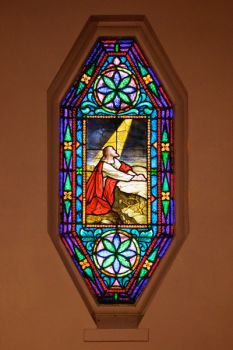 A solitary but beautiful stained glass window graces Our Savior's sanctuary.