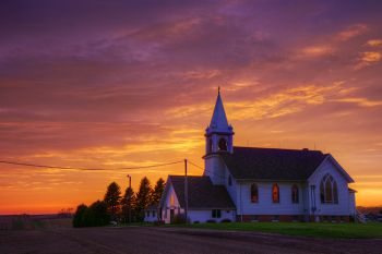 An early May sunset beyond historic Benton Lutheran near Crooks.