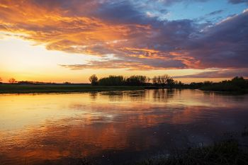 Sunset reflected in the Big Sioux River between Dell Rapids and Trent.