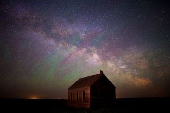 The rising Milky Way with airglow above the old Lightcap country school in Corson County.