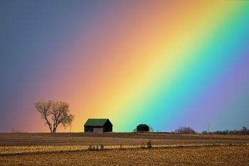 Rainbow in rural Minnehaha County shot with a telephoto lens.