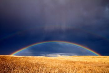 A double rainbow west of Vivian after an early autumn wind and rainstorm.