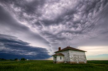 An approaching storm over an old country schoolhouse in southern Day County.