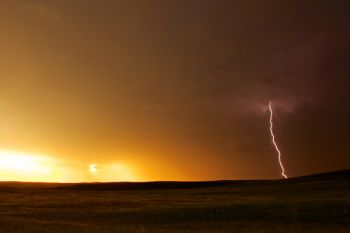 A lightning bolt near sunset on the open prairie of Corson County.