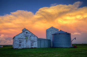 The setting sun coloring the Union County storm as seen from a local farmyard.