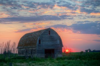 An unused barn at sunset along a county road in Hutchinson County.